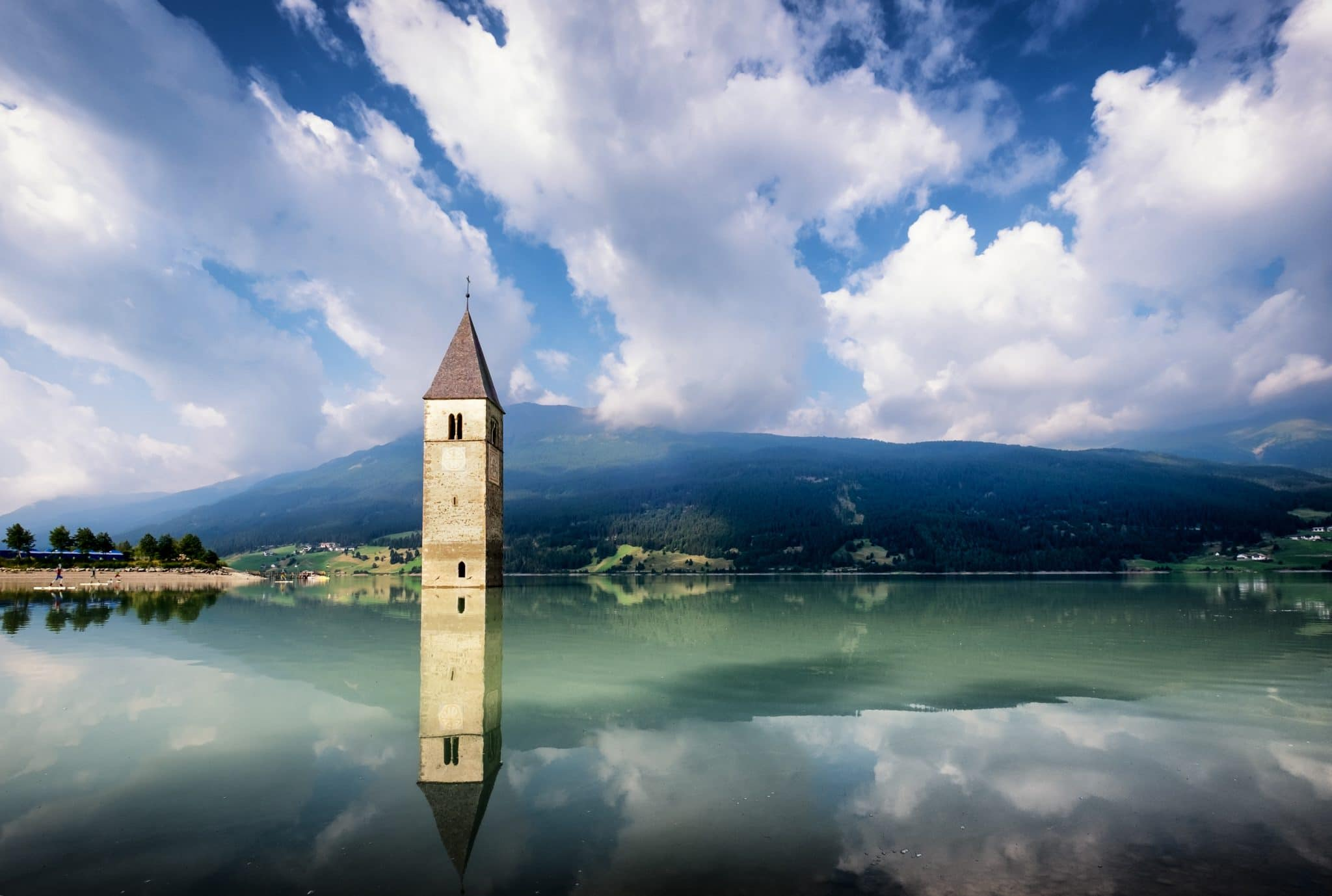 famous historic bell tower at the reschenpass - italy